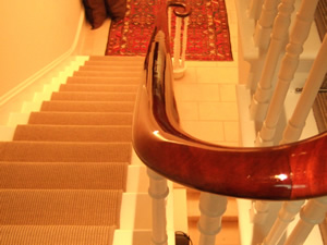 Mahogany Handrail Restored Using French Polishing Techniques