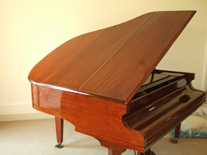 Mahogany Baby Grand Piano Restored With French Polishing Techniques